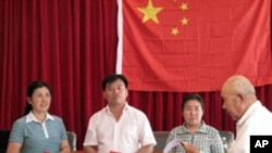 Announcing election results. Wei Xizhen and two others are elected members of the Xiwangping Villagers' Committee