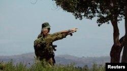 Binh sĩ Israel quan sát phía biên giới Syria.