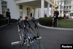 Microphones are seen outside of the Oval Office prior to the arrival of British Prime Minister Theresa May for a visit to U.S. President Donald Trump at the White House in Washington, Jan. 27, 2017.