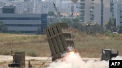 "FILE - A missile is launched by an ""Iron Dome"" battery in Ashdod, Israel, July 11, 2014. Israel is looking to boost the amount of money the United States sends it every year for military aid to as much as $5 billion."