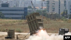 "FILE - A missile is launched by an ""Iron Dome"" battery, a short-range missile defense system designed to intercept and destroy incoming short-range rockets and artillery shells. The senators say in their letter to the president they are currently considering increasing that Israeli missile defense funding in 2017."