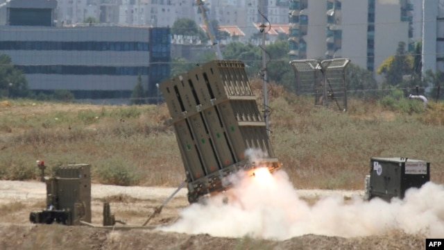 "A missile is launched by an ""Iron Dome"" battery, a short-range missile defense system on July 11, 2014 in the southern Israeli city of Ashdod."