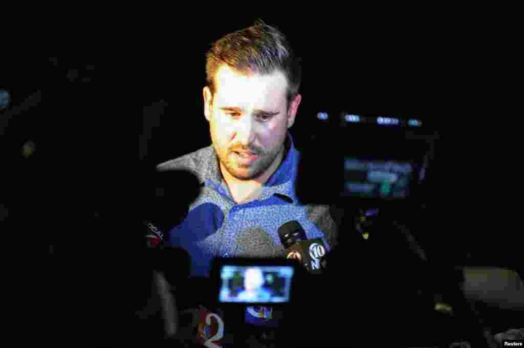 Chris Nault, cựu đồng đội trong đội bóng rugby với phóng viênMỹ Steven Sotloff phát biểu trong buổi cầu nguyện tại Đại học Central Floridaở Orlando, Florida, ngày 3/9/2014.