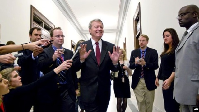 Senate Finance Committee Chairman Sen. Max Baucus, fends off reporters as he arrives to meet in the Capitol Hill office of Sen. John Kerry, and other Supercommittee members in Washington, Nov. 21, 2011