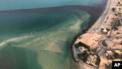 Photo released by Kuwait Environment Public Authority shows an oil spill near Kuwait's southern Ras al-Zour in Persian Gulf waters, Aug. 12, 2017.