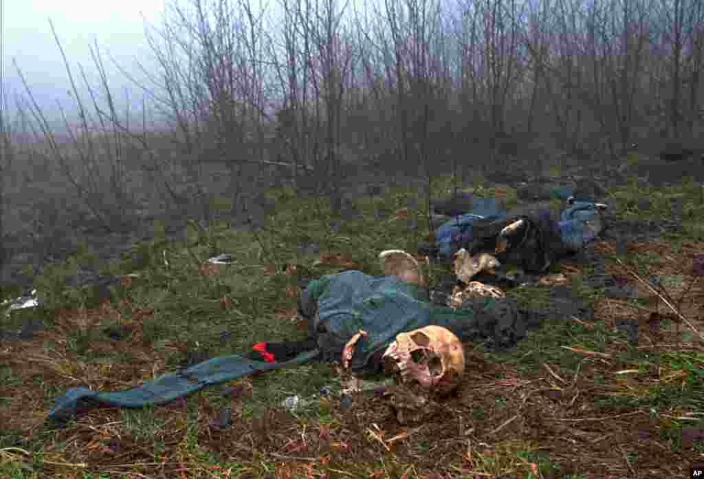 One of four clothed skeletons are on a hilltop just west of Srebrenica. (File 2006)