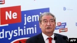FILE - Albania's then-Prime Minister Sali Berisha speaks during a press conference in Tirana, June 26, 2013.
