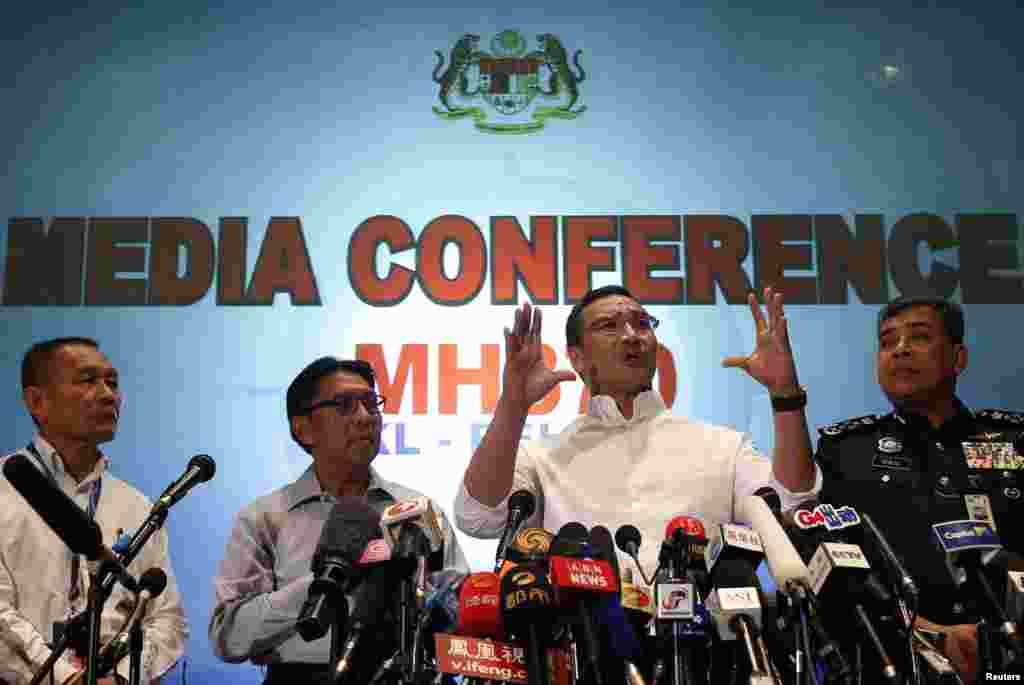 Malaysia's acting Transport Minister Hishammuddin Hussein (2nd right) speaks about flight MH370 at Kuala Lumpur International Airport, March 16, 2014.