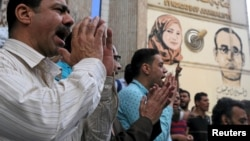 FILE - Journalists and activists protest against the restriction of press freedom and to demand the release of detained journalists, in front of the Press Syndicate in Cairo, Egypt, April 26, 2016.