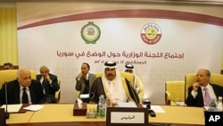 Arab League Secretary General, Nabil Elarabi, left, Qatari Prime Minister Sheikh Hamad bin Jassim bin Jabr al-Thani, center, and Ahmed bin Heli, the Arab League's assistant secretary-general for political affairs, during the group's meeting on Syria held