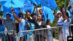 热比娅7月5日参加在中国驻华盛顿大使馆前的游行示威