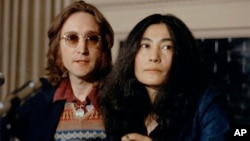 John Lennon and his wife Yoko Ono speak at a press conference, March 2, 1973, in New York. (AP Photo)