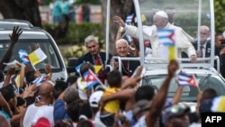 Pope Francis waves from the popemobile upon his arrival at El Cobre, Santiago de Cuba, to give a prayer at a basilica to Our Lady of Charity of El Cobre, the patron saint of Cuba, Sept. 21, 2015.