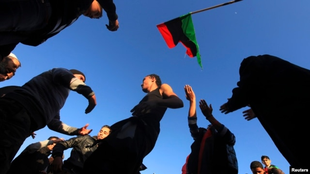 People dance as they mark the second anniversary of the country's revolution in Benghazi, Feb. 16, 2013.
