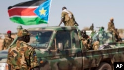 South Sudanese government soldier in Unity State, South Sudan, Sunday, Jan 12, 2014. A government official says an unspecified number of SPLA soldiers have been detained on suspicion they carried out targeted ethnic killings.