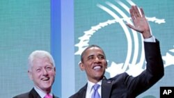 President Barack Obama and former President Bill Clinton shake hands at the Clinton Global Initiative in New York, Sept., 21, 2011