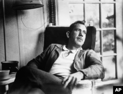 Author John Steinbeck, takes a rest from intense work on a new novel in an undated photo. (AP Photo)