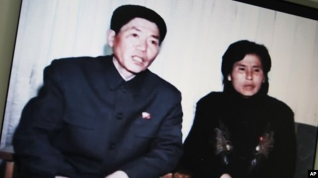 Screen shot of a N. Korea state website shows a video of an interview with N. Korean family who drifted into S. Korean waters aboard a fishing vessel last month, in Seoul, March 9, 2011