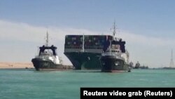 Egypt, Suez Canal, Ship Ever Given, one of the world's largest container ships, is seen after it was fully floated
