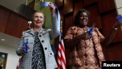 FILE - U.S. Secretary of State Hillary Clinton (L) attends a ribbon-cutting ceremony for the new U.S. Embassy with U.S. Ambassador to Liberia Linda Thomas-Greenfield (R) in Monrovia, Jan. 16, 2012.