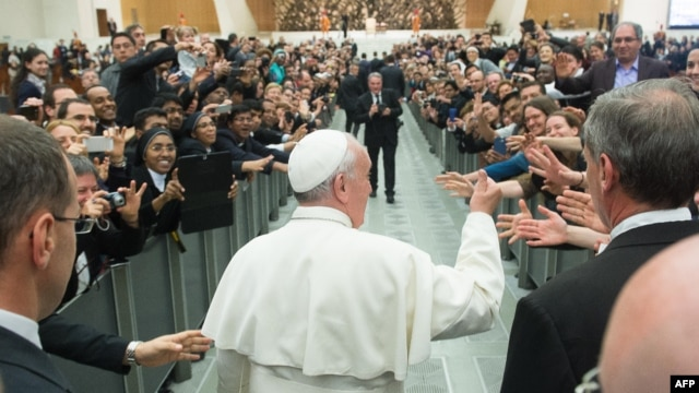 Image shows Pope Francis during a meeting with the community of the Pontifical Gregorian University, at Paul VI audience hall at the Vatican, April 10, 2014.