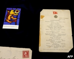 FILE - Artifacts related to the Titanic, including the last luncheon menu, are displayed ahead of an auction at Lion Heart Autographs in New York, Sept. 28, 2015.