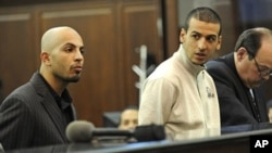 Ahmed Ferhani 26, left, and Mohamed Mamadouh 20, appear in court with their attorneys for arraignment, at Criminal Court in New York. Both men are charged with a terrorist plot targeting New York synagogues, May 12, 2011