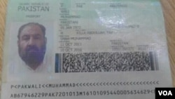 FILE - A photo shows the Pakistani passport and ID card that Mullah Akhtar Mansoor was allegedly carrying. Mansoor was killed in a U.S. drone strike Saturday near the Pakistan-Afghanistan border.