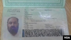 A photo shows a Pakistani passport and ID card that Mullah Akhtar Mansoor was allegedly carrying, although questions are being asked how the documents could have survived the drone strike.