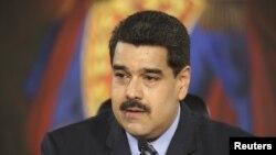 Tổng thống Venezuela Nicolas Maduro phát biểu trong một cuộc họp tại Miraflores Palace, tại Caracas. Hình ảnh được cung cấp bởi Miraflores Palace ngày 17 tháng 2 năm 2016.
