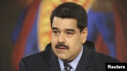 FILE - Venezuela's President Nicolas Maduro speaks during a meeting at Miraflores Palace, in Caracas, in this handout picture provided by Miraflores Palace, Feb. 17, 2016.
