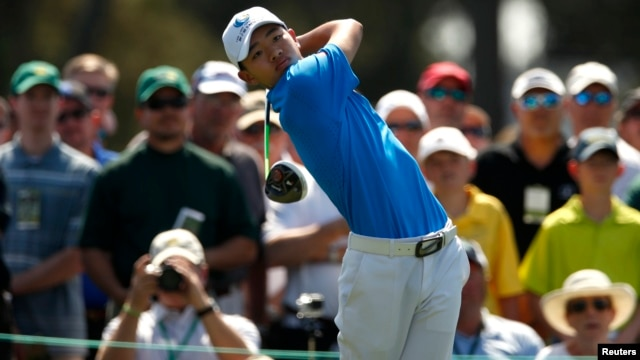 Asia-Pacific Amateur Championship winner, 14-year-old Guan Tianlang of China hits his tee shot on the first hole during a practice round in preparation for the 2013 Masters tournament at Augusta National Golf Club in Augusta, Georgia, Apr. 9, 2013.