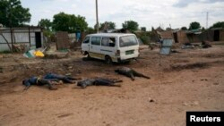 The bodies of civiliansline a road in Bentiu, Unity state last year. South Sudan Information Minister Michael Makuei defends an African Union decision to delay a report on rights violations during South Sudan's conflict.
