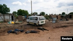 Bodies of civilians who were killed in a surge in Unity state last year, lie at the side of the road in the state capital Bentiu.