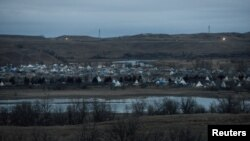 FILE - The protest encampment is seen during a protest against plans to pass the Dakota Access pipeline near the Standing Rock Indian Reservation, near Cannon Ball, N.D., Nov. 17, 2016.