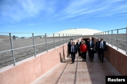 Chile's President Michelle Bachelet and Director General of the European Southern Observatory, Tim de Zeeuw walk at the construction site of the world's largest telescope in the desert of Atacama, Chile, May 26, 2017.
