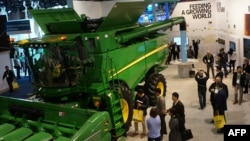 "Farm equipment maker John Deere made its debut at the Consumer Electronics Show, Jan. 9, 2019, in Las Vegas with a connected combine harvester, described as an ""intelligent factory on wheels."" It uses GPS, artificial intelligence and sensor technology to"