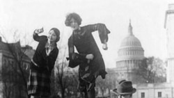 Congressman T.S. McMillan of Charleston, South Carolina with two women who are doing the Charleston dance near the Capitol building in Washington D.C.
