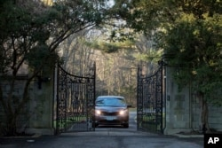 FILE - A car with diplomatic license plates is seen leaving a compound near Glen Cove, New York, Dec. 30, 2016. The compound is one of the estates whose return Russia is demanding. The other is located in Centreville, Maryland, some 90 km outside of Washington, D.C.
