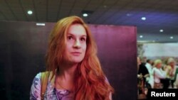 FILE - Maria Butina speaks at 2015 FreedomFest conference in Las Vegas, Nevada, July 11, 2015 in this still image taken from a social media video obtained July 19, 2018.
