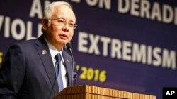 In this Monday, Jan. 25, 2016 photo, Malaysian Prime Minister Najib Razak speaks at a conference in Kuala Lumpur, Malaysia.