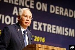 FILE - Malaysian Prime Minister Najib Razak speaks at a conference in Kuala Lumpur, Malaysia.