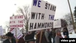 FILE - In a video grab, members of a militia group in the northwestern U.S. state of Oregon are seen rallying in support of two ranchers they say have received an unjust court sentence.