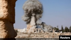 FILE - An image distributed by Islamic State militants on social media on August 25, 2015 purports to show the destruction of a Roman-era temple in the ancient Syrian city of Palmyra.