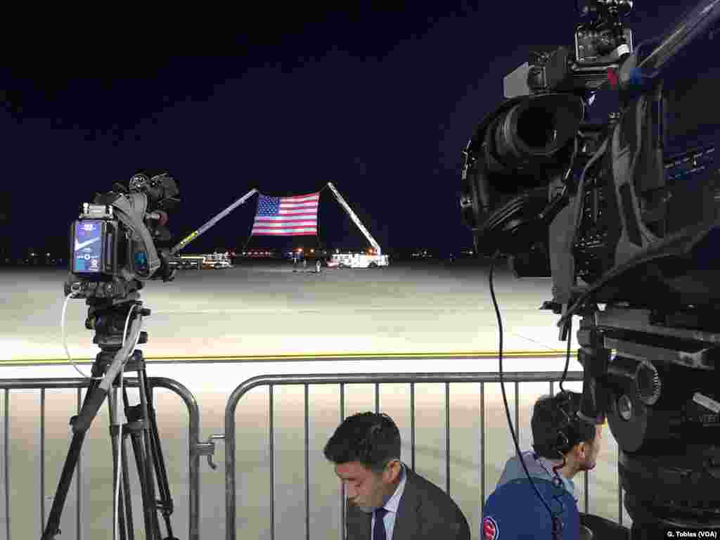 The press awaits arrival of President Donald Trump, Vice President Mike Pence, Secretary of State Mike Pompeo and the three Americans released from North Korea, early May 10, 2018, Andrews Air Force Base.