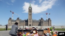 Canadian Prime Minister Justin Trudeau visits the makeshift memorial erected in honor of the 215 indigenous children remains found at a boarding school in British Columbia, on Parliament Hill June 1, 2021 in Ottawa.