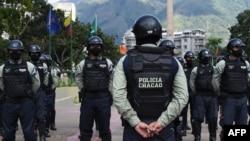 FILE - Municipal police officers prepare for a security operation, in Caracas, Venezuela, Dec. 1, 2020.