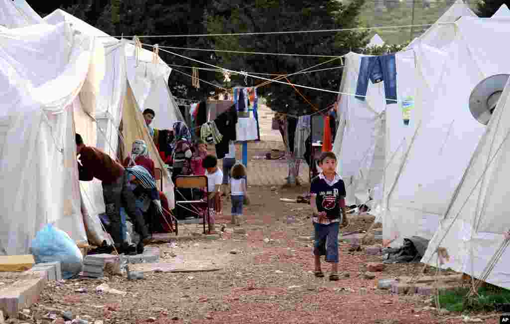 In this photo taken April 9, 2012, Syrian refugees are seen at a camp in Reyhanli, Turkey. Turkey's prime minister accused Syria of infringing its border and said Tuesday that his country is considering what steps to take in response, including measures ""