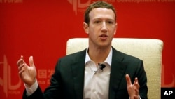 FILE - Facebook CEO Mark Zuckerberg speaks during a panel discussion in Beijing, March 19, 2016. The world's biggest social network is starting to face the consequences of not preventing the often unforeseen problems that keep cropping up on its platform, from false news to real ads from agents of the Russian government looking to influence the U.S. election.