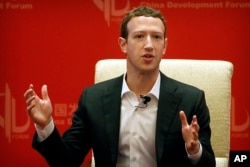 FILE - Facebook CEO Mark Zuckerberg speaks during a panel discussion in Beijing, March 19, 2016.